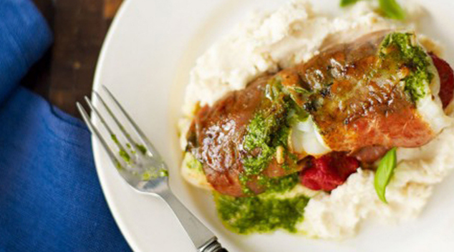 Prosciutto-wrapped haddock on butterbean mash